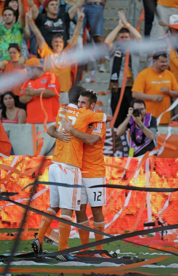 Houston Dynamo Will Bruin, right, celebrates his goal with teammate  Bobby Boswell, left, during second half against the Sporting Kansas City during the MLS Eastern Conference semifinal at the BBVA Compass Stadium Sunday, Nov. 4, 2012, in Houston. Photo: Melissa Phillip, Houston Chronicle / © 2012 Houston Chronicle