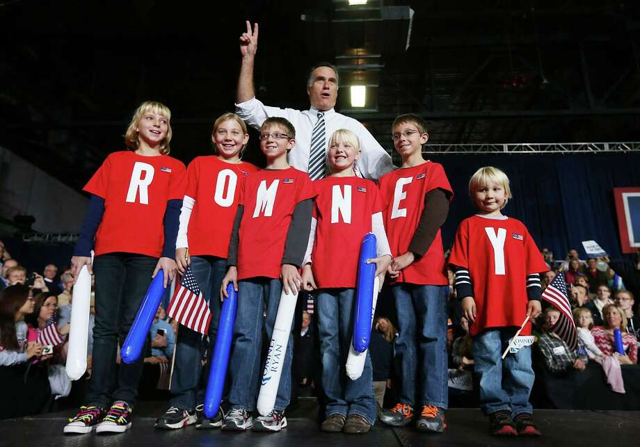 DES MOINES, IA - NOVEMBER 04:  Republican presidential candidate, former Massachusetts Gov. Mitt Romney greets supporters as he poses with children during a campaign rally at the Hy Vee Center on November 4, 2012 in Des Moines, Iowa. With two days before election day, Mitt Romney is campaigning in swing states across the country. Photo: Justin Sullivan, Getty Images / 2012 Getty Images