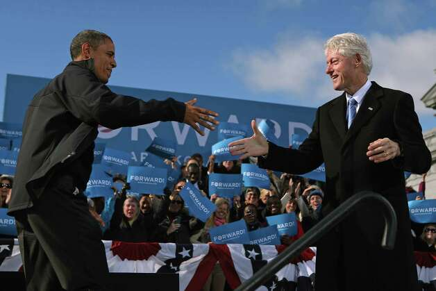 "CONCORD, NH - NOVEMBER 04:  U.S. President Barack Obama (L) is welcomed to the stage by former President Bill Clinton during a campaign rally in State Capitol Square November 4, 2012 in Concord, New Hampshire. With only two days left until the presidential election, Obama and his opponent, former Massachusetts Gov. Mitt Romney are stumping from one ""swing state"" to the next in a last-minute rush to persuade undecided voters. Photo: Chip Somodevilla, Getty Images / 2012 Getty Images"
