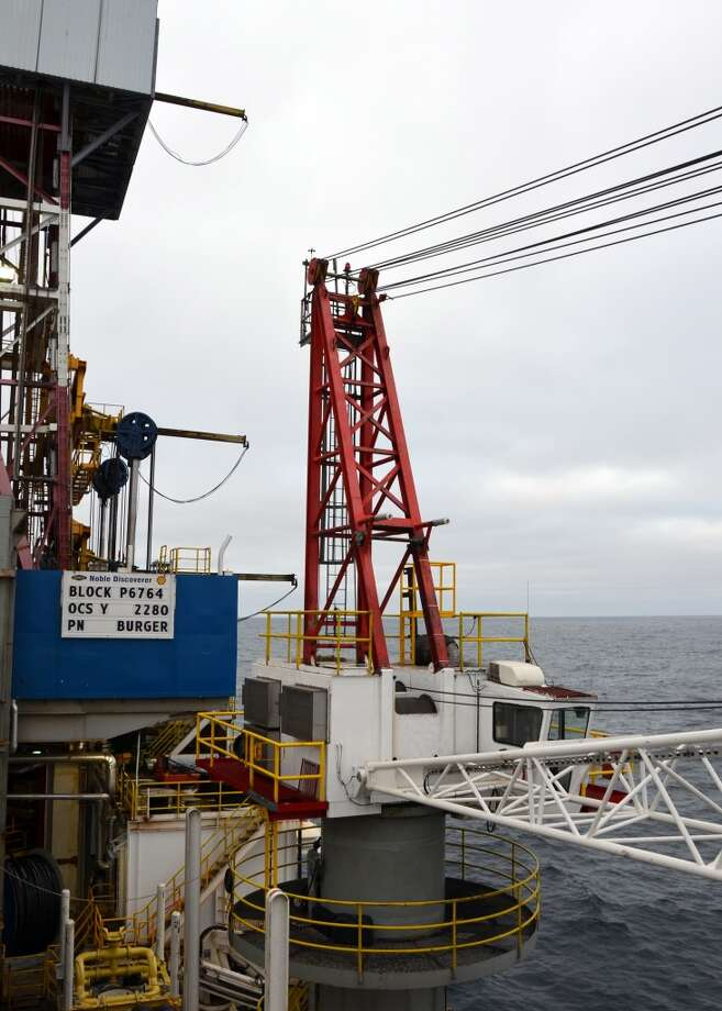 Shown here is one of the two cranes on the drillship Noble Discoverer, which Shell is using to search for oil in the Chukchi Sea north of Alaska. The cranes can't be used once the temperature dips below 0 degrees celsius -- a challenge in this chilly, Arctic environment. (Photo: Jennifer A. Dlouhy / The Houston Chronicle) (Houston Chronicle)