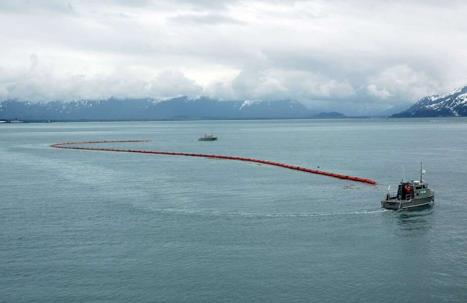 Inflatable boom stretches between two oil spill response vehicles in Valdez waters during a Shell training exercise. When not at work, these two oil spill response vessels -- and a third -- will be housed on the Nanuq. (Jennifer A. Dlouhy / The Houston Chronicle) (The Houston Chronicle)