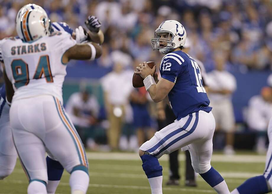Andrew Luck sets up to fire one of his 48 passes on a day when he set a rookie yardage record. Photo: Darron Cummings, Associated Press
