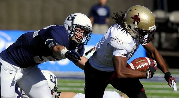 Texas State wide receiver Ben Ijah carries the ball as Utah State linebacker Kyler Fackrell defends during their NCAA college football game, Saturday, Nov. 3, 2012, in Logan, Utah. (AP Photo/The Herald Journal, Eli Lucero) (Associated Press)