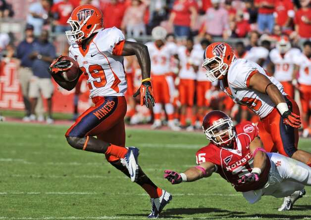 UTEP's Autrey Golden (29) eludes the grasp of Houston's Kenneth Farrow (35) during the first half of an NCAA college football game Saturday, Oct. 27, 2012, in Houston. (AP Photo/Pat Sullivan) (Associated Press)