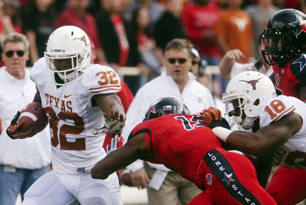 Texas running back Johnathan Gray (32) motions to stiff arm Texas Tech safety D.J. Johnson (12) during their NCAA college football game, Saturday, Nov. 3, 2012, in Lubbock, Texas. Texas won 31-22. (AP Photo/The Odessa American, Albert Cesare) (Associated Press)