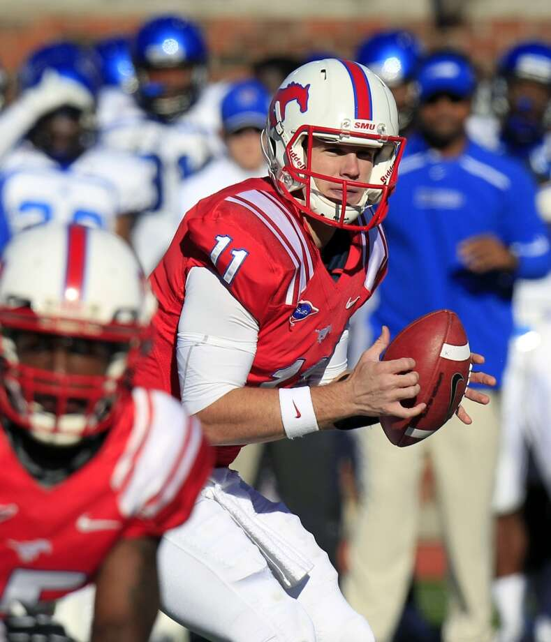 SMU quarterback Garrett Gilbert (11) looks to pass during the second half of an NCAA college football game Saturday, Oct. 27, 2012, in Dallas. SMU won 44-13. (AP Photo/LM Otero) (Associated Press)