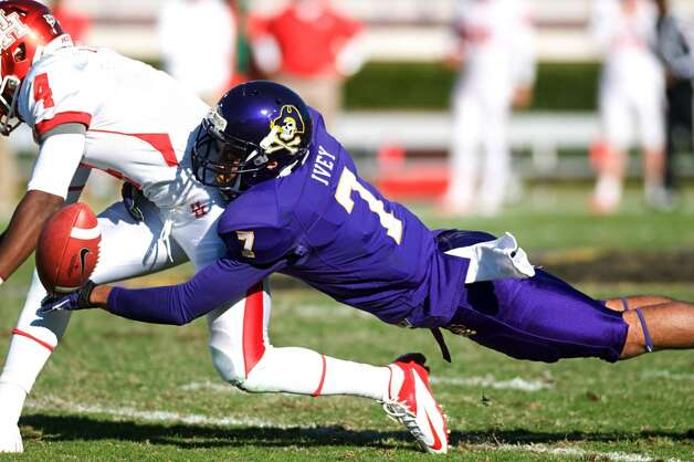 East Carolina's Lamar Ivey (7) breaks up a pass intended for Houston's Ronniw Williams (4) during their NCAA college football game, Saturday, Nov. 3, 2012, in Greenville, N.C. East Carolina won 48-28. (AP Photo/The Daily Reflector, Scott Davis) (Associated Press)