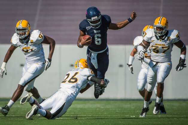 Rice quarterback Driphus Jackson (6) is tripped up by Southern Miss defensive back DeBarrius Miller (26) during the fourth quarter of an NCAA college football game at Rice Stadium, Saturday, Oct. 27, 2012, in Houston. Rice won the game 44-17.(AP Photo/Houston Chronicle, Smiley N. Pool) (Associated Press)