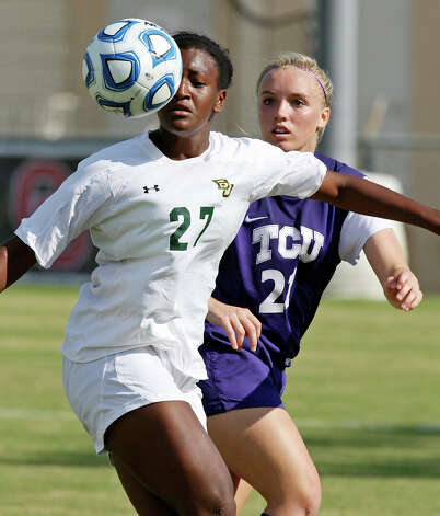 Baylor's Vic Hoffman and TCU's Rebekah Foreman eye the ball during second half action Sunday Nov. 4, 2012 during the 2012 Big 12 Soccer Championship match. Baylor won 4-1. Photo: Edward A. Ornelas, Express-News / © 2012 San Antonio Express-News