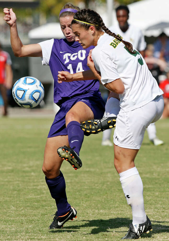 TCU's Kelly Johnson and Baylor's Lisa Sliwinski go after the ball during first half action Sunday Nov. 4, 2012 during the 2012 Big 12 Soccer Championship match. Baylor won 4-1. Photo: Edward A. Ornelas, Express-News / © 2012 San Antonio Express-News