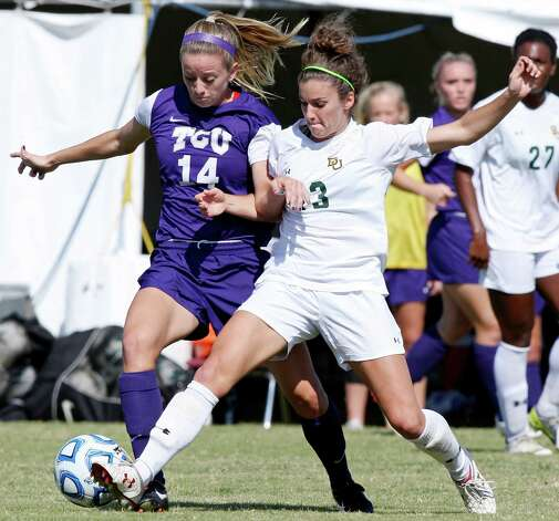 TCU's Kelly Johnson and Baylor's Hanna Gilmore struggle for control of the ball during first half action Sunday Nov. 4, 2012 during the 2012 Big 12 Soccer Championship match. Baylor won 4-1. Photo: Edward A. Ornelas, Express-News / © 2012 San Antonio Express-News