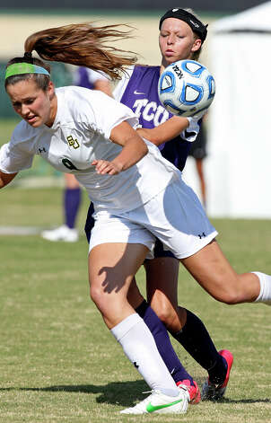 Baylor's Alex Klein and TCU's Serena Smith-Banas struggle for control of the ball during first half action Sunday Nov. 4, 2012 during the 2012 Big 12 Soccer Championship match. Baylor won 4-1. Photo: Edward A. Ornelas, Express-News / © 2012 San Antonio Express-News