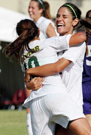 Baylor's Bri Campos (left) celebrates with Larissa Campos after Larissa scored a goal during second half action againt TCU Sunday Nov. 4, 2012 during the 2012 Big 12 Soccer Championship match. Baylor won 4-1. Photo: Edward A. Ornelas, Express-News / © 2012 San Antonio Express-News