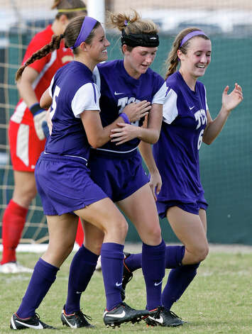 TCU's Madeline Hamm (from left), Lindsy Schafer, and Carly Bowen celebrate after Schafer scored a goal against Baylor during second half action Sunday Nov. 4, 2012 during the 2012 Big 12 Soccer Championship match. Baylor won 4-1. Photo: Edward A. Ornelas, Express-News / © 2012 San Antonio Express-News