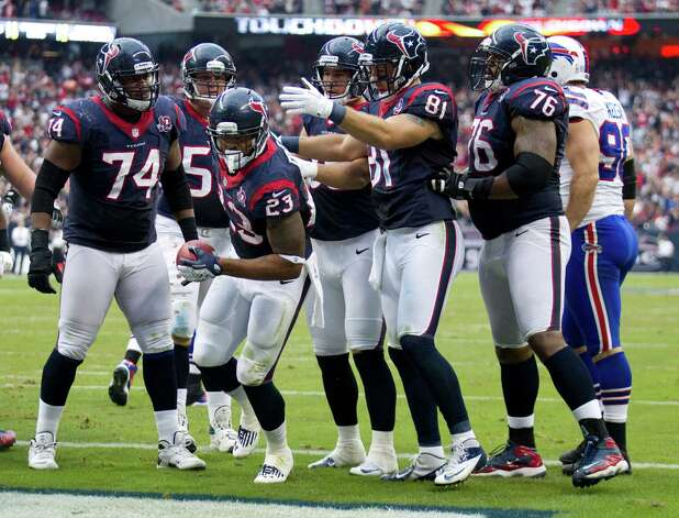 Houston Texans running back Arian Foster (23) is surrounded by his teammate after scoring on a 3-yard touchdown run against the Buffalo Bills during the third quarter at Reliant Stadium on Sunday, Nov. 4, 2012, in Houston. Photo: Brett Coomer, Houston Chronicle / © 2012  Houston Chronicle