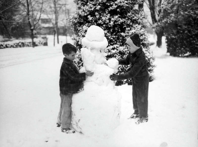 This picture from the snowstorm of Jan. 19, 1943 shows Howard Swalwell and Larry Sullins making a sn