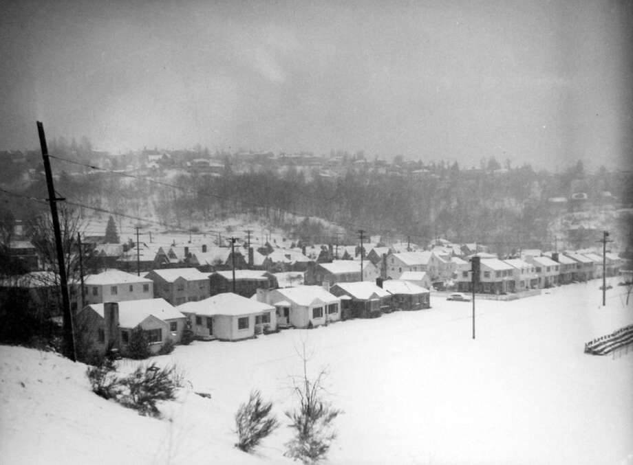 This picture shows a Seattle neighborhood in the snowstorm of Jan. 19, 1943. But information about exactly where it was taken was not recorded, and the image was not previously published in the P-I. (Copyright MOHAI, Seattle Post-Intelligencer Collection, PI28398. Click for reproductions.) Photo: -