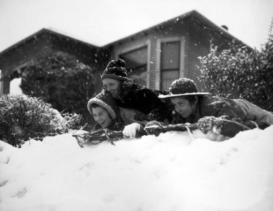 Stores and schools closed early on Jan. 19, 1943, when Seattle was hit with the worst snowstorm in two decades. These kids took advantage of the weather, and were captured by a P-I photographer. But until now, the image has not been published in the P-I. (Copyright MOHAI, Seattle Post-Intelligencer Collection, PI28400. Click for reproductions.) Photo: -