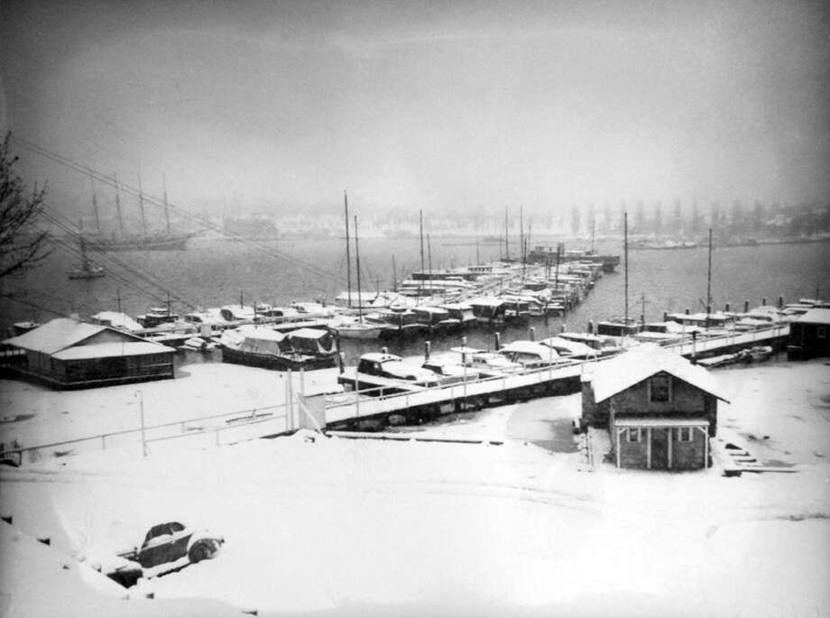 This picture from Jan. 19, 1943 shows Seattle Yacht Club moorage in the snowstorm of Jan. 19, 1943, which was the worst in two decades in Seattle. (Copyright MOHAI, Seattle Post-Intelligencer Collection, PI28397. Click for reproductions.) Photo: -