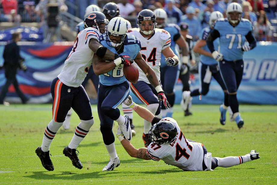 The Bears' Charles Tillman, left, strips the ball from receiver Kenny Britt on the Titans' first offensive play. Tillman forced three other fumbles Sunday. Photo: Frederick Breedon, Stringer / 2012 Getty Images