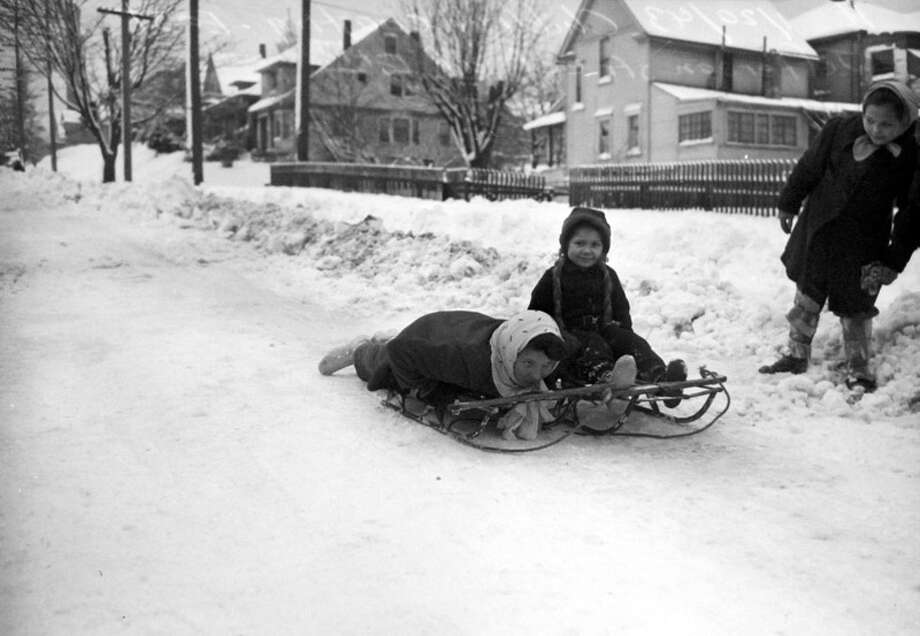 Taken Jan. 20, 1943, this picture shows kids near East Jefferson Street and 18th Avenue. The storm that hit that day was the worst Seattle had seen in two decades. It closed the main Boeing plant, the shipyards, and all Seattle schools. (Copyright MOHAI, Seattle Post-Intelligencer Collection, PI28403. Click for reproductions.) Photo: -