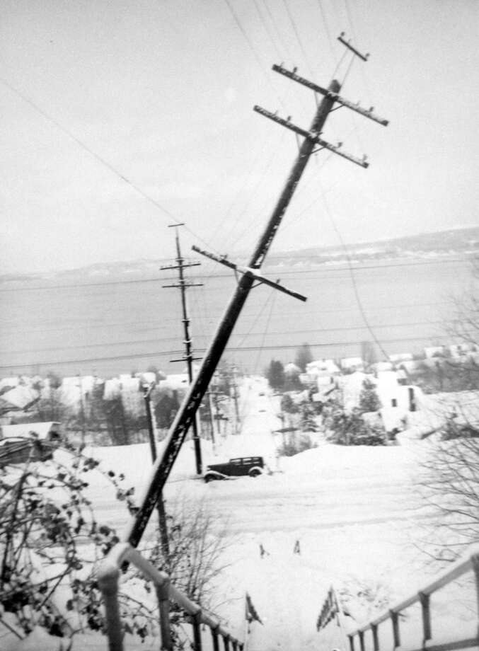 The Jan. 1943 snowstorm was so strong it knocked over this utility pole at 30th Avenue South and Dearborn Street. It was published on the back page of the P-I's front section on Jan. 21, 1943. (Copyright MOHAI, Seattle Post-Intelligencer Collection, PI28404. Click for reproductions.) Photo: -
