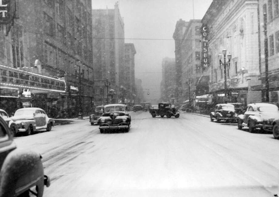 Pike Street was a mess during the snow that shut down Seattle on Feb. 1, 1947. The Coliseum is on the right, and that's now the downtown Banana Republic store. The Roosevelt Theatre, which has been demolished, is barely in the left of the frame. (Copyright MOHAI, Seattle Post-Intelligencer Collection, PI28421. Click for reproductions.) Photo: -