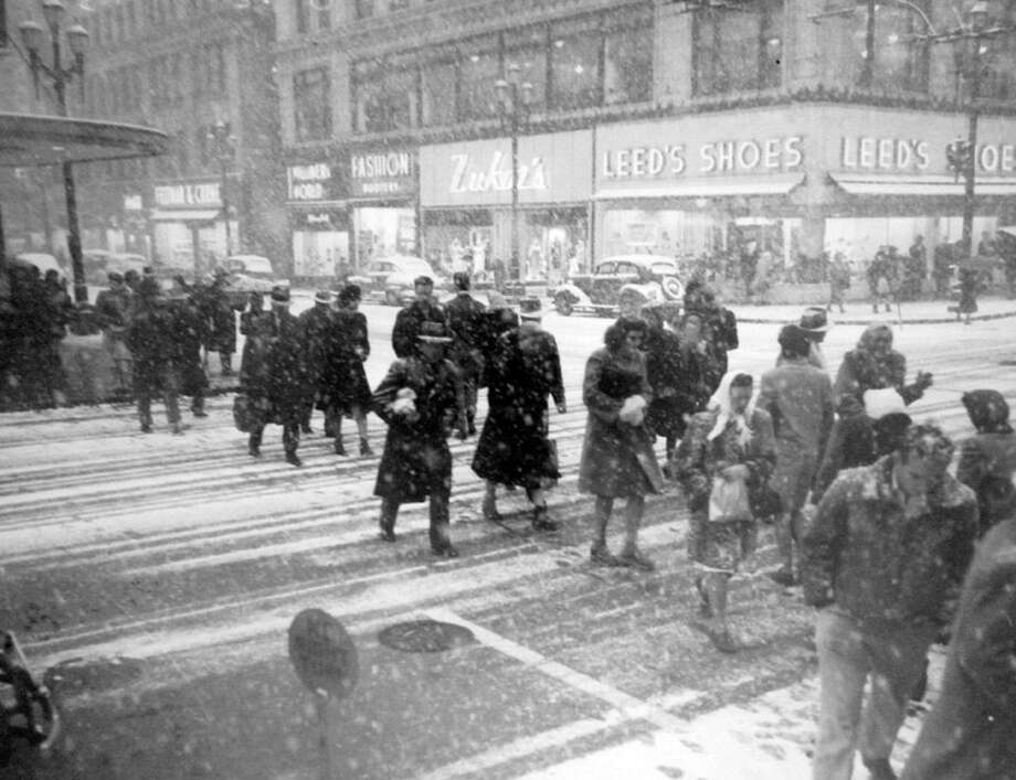 This picture, also from Feb. 1, 1947, shows pedestrians crossing Third Avenue at Pike Street in the snow. (Copyright MOHAI, Seattle Post-Intelligencer Collection, PI28420. Click for reproductions.) Photo: -