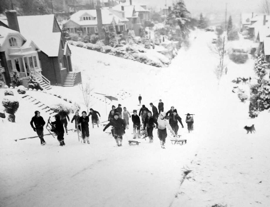 This photo from Jan. 11, 1937 shows kids going up the East Roanoke hill in Seattle. That month had one of the heaviest snowfalls of that decade in Seattle. (Copyright MOHAI, Seattle Post-Intelligencer Collection, PI28383. Click for reproductions.) Photo: -