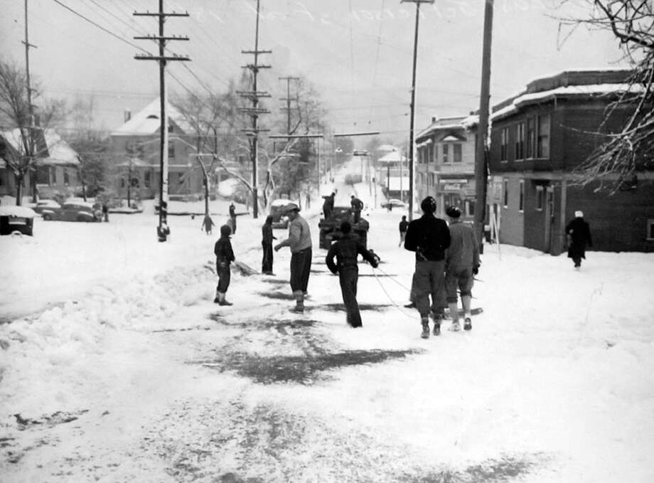 Here's another picture from the snowstorm of Jan. 19, 1943, which was the worst to hit Seattle in two decades. This previously unpublished picture was taken on Queen Anne Hill, though a photographer and exact location was not recorded by the P-I staff. (Copyright MOHAI, Seattle Post-Intelligencer Collection, PI28402. Click for reproductions.) Photo: -