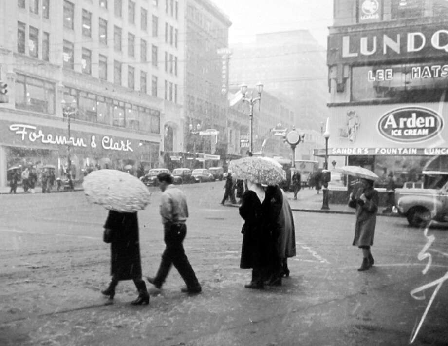 Pedestrians cross Fourth Avenue at Pike street in the snow of Jan. 24, 1949. The Foreman and Clark building is now home to Ben Bridge. (Copyright MOHAI, Seattle Post-Intelligencer Collection, PI28428. Click for reproductions.) Photo: -