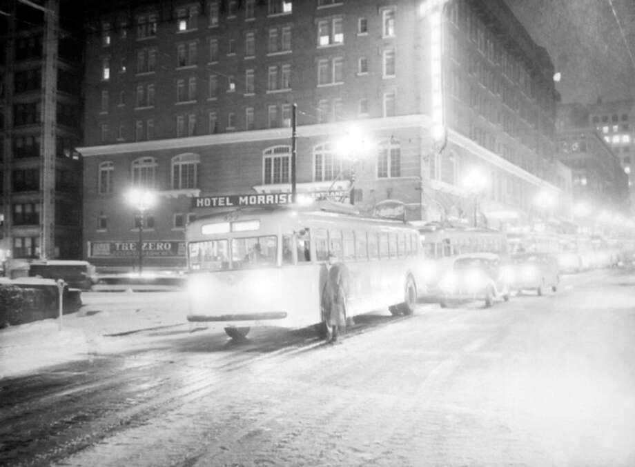This scene shows trolley buses having trouble in the snow on Third Avenue. The picture, taken Feb. 1, 1947, shows the Morrison Hotel in the background. The King County Courthouse is out of the frame to the right. (Copyright MOHAI, Seattle Post-Intelligencer Collection, PI28420. Click for reproductions.) Photo: -
