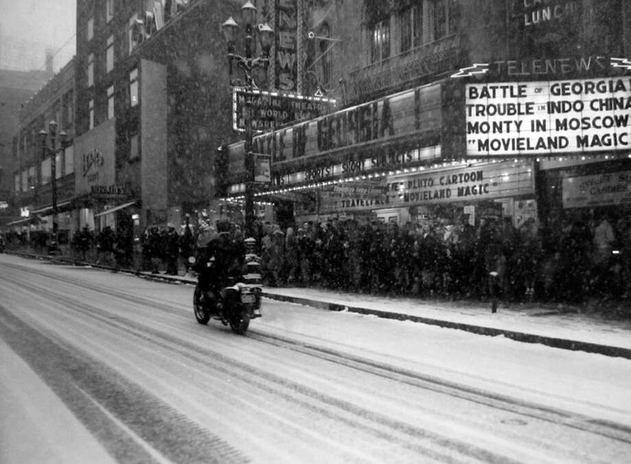 The bus system was jammed in the Seattle snowstorm of Feb. 1, 1947. More than 100 people were waiting on Third Avenue when an unknown P-I photographer snapped this picture. (Copyright MOHAI, Seattle Post-Intelligencer Collection, PI28419. Click for reproductions.) Photo: -