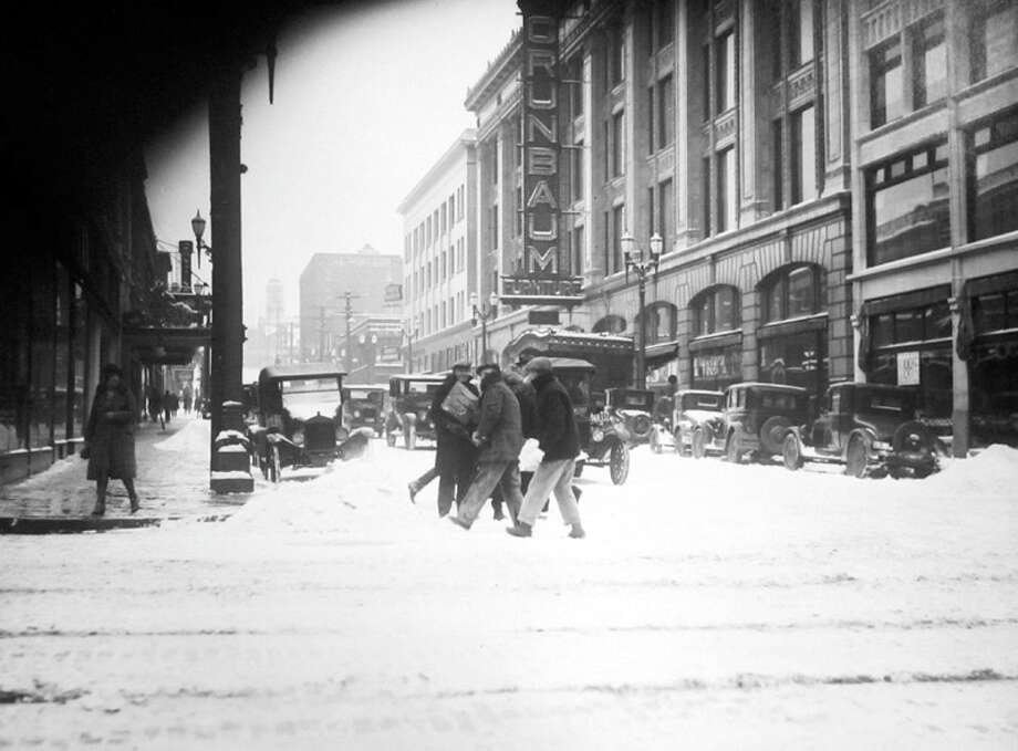 In this scene, pedestrians cross Sixth Avenue at Pine Street in the snow of March 3, 1929. The sign on the right is for Grunbaum Furniture Company. (Copyright MOHAI, Seattle Post-Intelligencer Collection, PI28377. Click for reproductions.) Photo: -