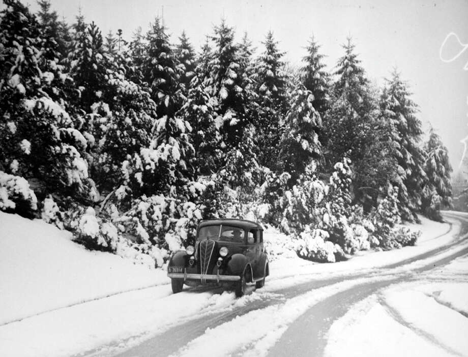This is a car on a path in Seattle's Volunteer Park, Dec. 11, 1937. That day, some parts of Seattle had 7.5 inches of snow. (Copyright MOHAI, Seattle Post-Intelligencer Collection, PI28392. Click for reproductions.) Photo: -