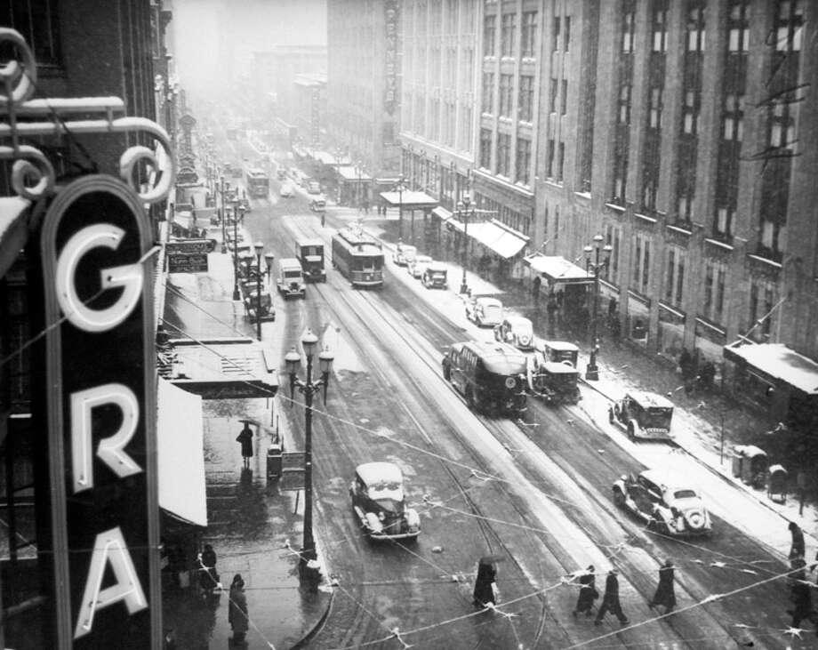 This picture shows Second Avenue during the Jan. 28, 1937 snow. The former JCPenney building is on the right. This picture was not previously published in the P-I, but preserved at the Museum of History and Industry. (Copyright MOHAI, Seattle Post-Intelligencer Collection, PI28386. Click for reproductions.) Photo: -