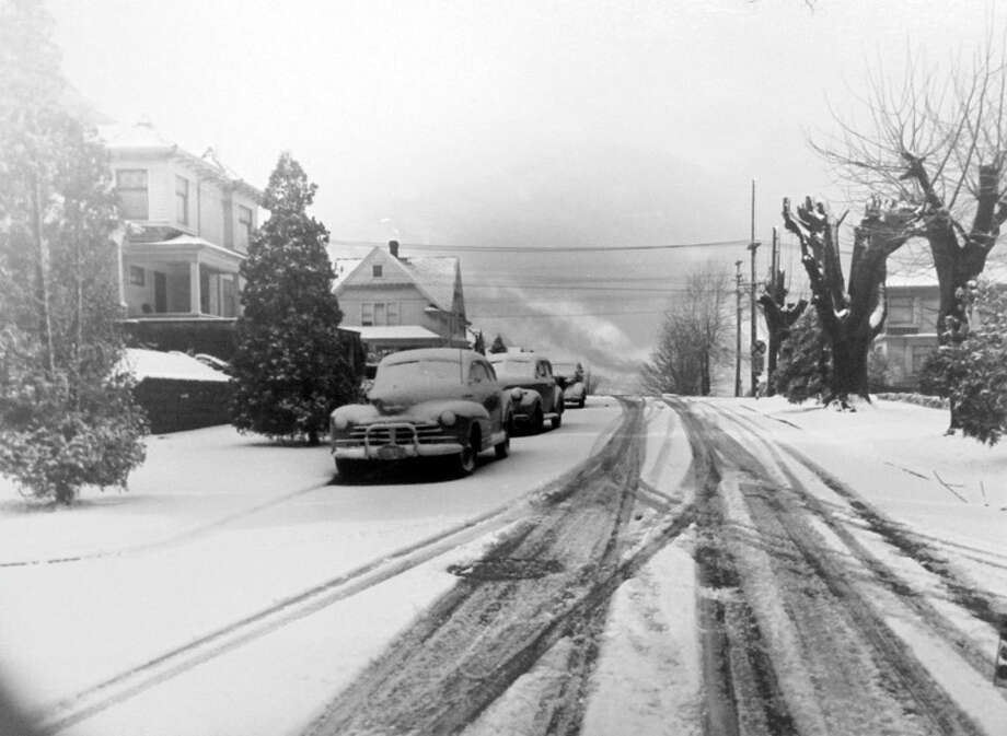 This picture shows part of Queen Anne Hill in the snow of Jan. 11, 1949. That was a blustery month in Seattle. (Copyright MOHAI, Seattle Post-Intelligencer Collection, PI28429. Click for reproductions.) Photo: -