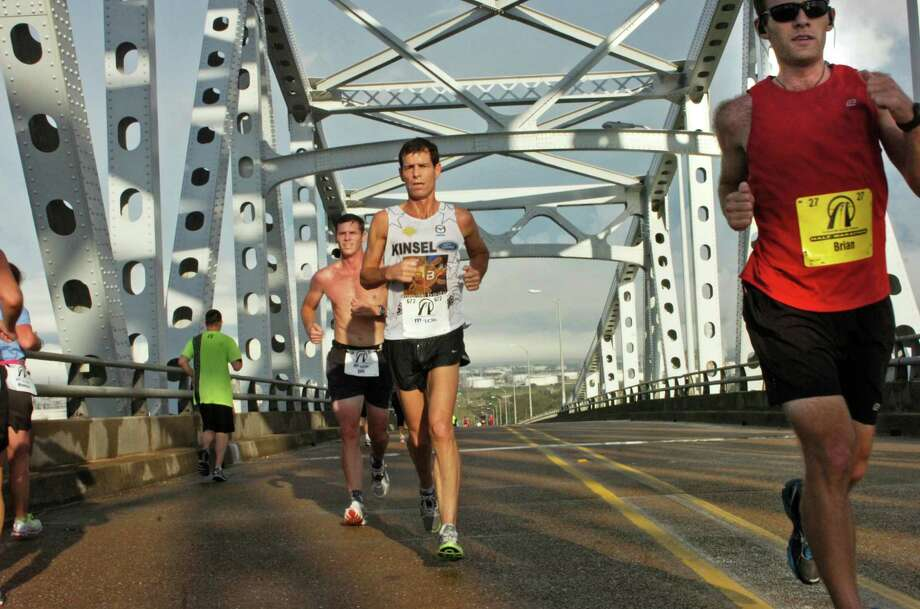 Runners sprint across the bridge during the Pleasure Island Bridge Half Marathon, 10K and 2-mile run Saturday morning in Port Arthur. Photo: Sarah Moore