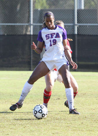 Stephen F. Austin's Zuri Prince tries to maintain possession of the ball during SFA's 2-1 win over Lamar in the Southland Conference championship game Sunday in Lake Charles, La. Prince, a Kelly graduate, posted a goal and an assist and was named tournament MVP. (Matt Billiot/Special to the Enterprise)