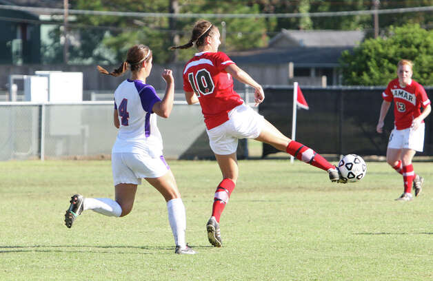 Lamar's Kristin Bos, No. 10, passes the ball during Lamar's 2-1 loss to Stephen F. Austin Sunday in the Southland Championshiop game at Cowgirl Field. (Matt Billiot/Special to the Enterprise)