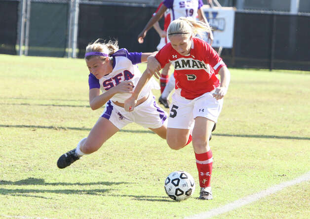 Lamar's Lorna Maudslay, No. 5, breaks past an SFA player during Lamar's 2-1 loss to Stephen F. Austin Sunday in the Southland Conference tournament championship game in Lake Charles, La. (Matt Billiot/Special to the Enterprise)
