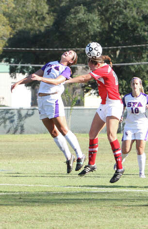 Lamar's Kristin Bos, right, heads the ball during Lamar's 2-1 loss to Stephen F. Austin Sunday in the Southland Conference tournament championship game in Lake Charles, La. (Matt Billiot/Special to the Enterprise)