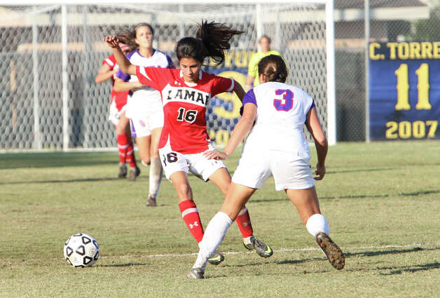 Lamar's Jannet Hernandez, No. 16, tries to pass an SFA player during Lamar's 2-1 loss to Stephen F. Austin Sunday in the Southland Conference tournament championship game in Lake Charles, La. (Matt Billiot/Special to the Enterprise)