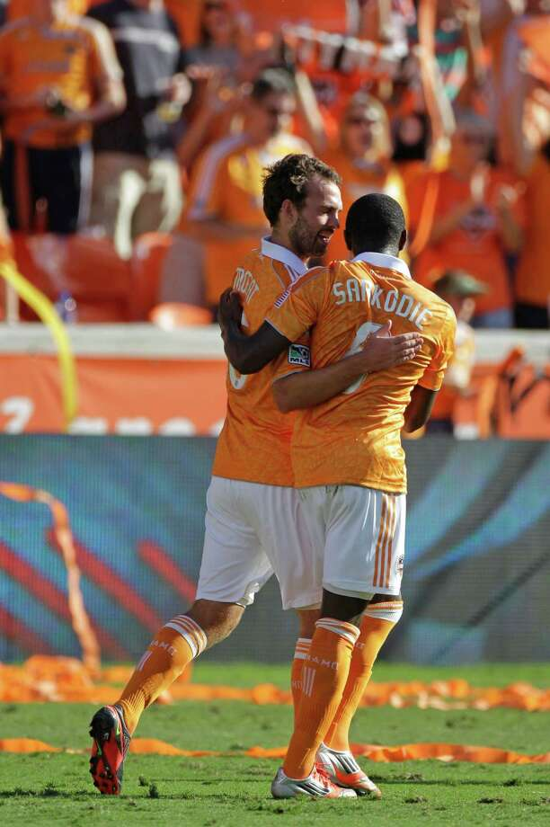 Houston Dynamo Adam Moffat, left, celebrates his goal with teammate Kofi Sarkodie, right, during first half against the the Sporting Kansas City in the MLS Eastern Conference semifinal at the BBVA Compass Stadium Sunday, Nov. 4, 2012, in Houston. Photo: Melissa Phillip, Houston Chronicle / © 2012 Houston Chronicle