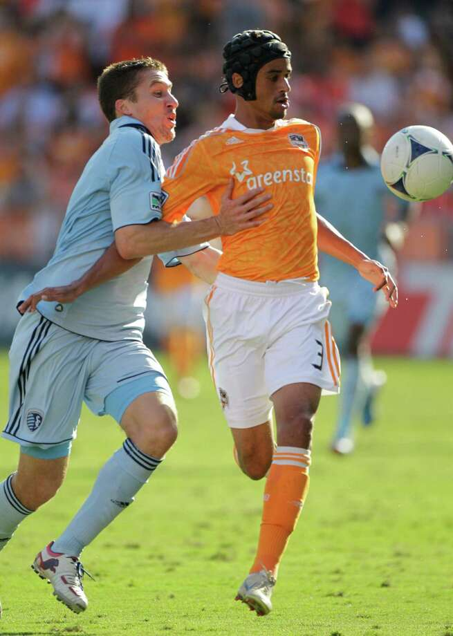 Sporting Kansas City Matt Besler, left, and Houston Dynamo Calen Carr, right, tangle over ball during the first half of MLS Eastern Conference semifinal at the BBVA Compass Stadium Sunday, Nov. 4, 2012, in Houston. Photo: Melissa Phillip, Houston Chronicle / © 2012 Houston Chronicle