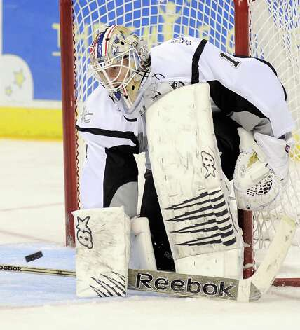 San Antonio Rampage goaltender Dov Grumet-Morris makes a save during the third period of an AHL hockey game against the Oklahoma City Barons, Sunday, Nov. 4, 2012, in San Antonio. San Antonio won 2-0. Photo: Darren Abate, Pressphotointl.com / Darren Abate/pressphotointl.com