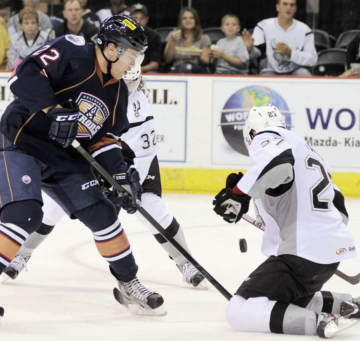 Oklahoma City Barons' Taylor Hall, left, battles San Antonio Rampage's Greg Rallo for the puck during the third period of an AHL hockey game, Sunday, Nov. 4, 2012, in San Antonio. San Antonio won 2-0.