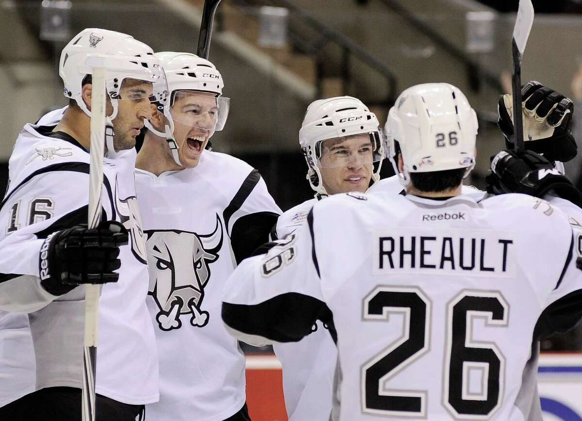 San Antonio Rampage players Andre Deveaux, from left, Alex Petrovic, John McFarland, and Jon Rheault celebrate a second period goal by Petrovic during an AHL hockey game against the Oklahoma City Barons, Sunday, Nov. 4, 2012, in San Antonio.