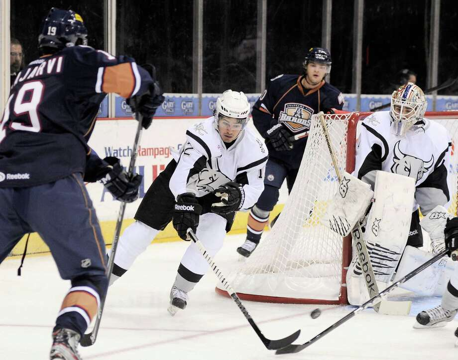 San Antonio Rampage center Jared Gomes (12) and Rampage goaltender Dov Grumet-Morris, right, defend the net against Oklahoma City Barons' Magnus Paajarvi, left, during the first period of an AHL hockey game, Sunday, Nov. 4, 2012, in San Antonio. Photo: Darren Abate, Pressphotointl.com / Darren Abate/pressphotointl.com