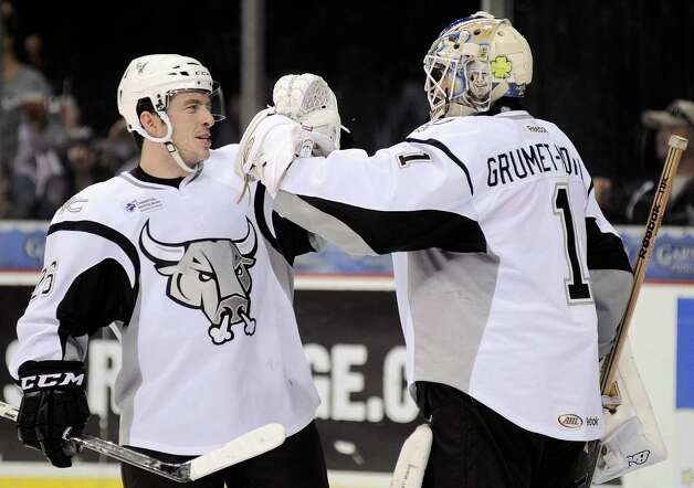 San Antonio Rampage right wing Jon Rheault, left, congratulates Rampage goaltender Dov Grumet-Morris on his shutout win after an AHL hockey game against the Oklahoma City Barons, Sunday, Nov. 4, 2012, in San Antonio. San Antonio won 2-0. Photo: Darren Abate, Pressphotointl.com / Darren Abate/pressphotointl.com